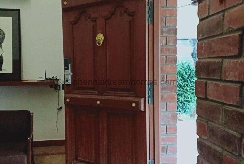 decorative front door with numbered lock